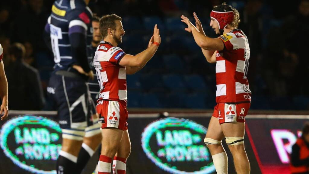 SALFORD, ENGLAND - SEPTEMBER 16:  Greig Laidlaw of Gloucester Rugby celebrates with Jacob Rowan after the Aviva Premiership match between Sale Sharks and Gloucester Rugby at AJ Bell Stadium on September 16, 2016 in Salford, England.  (Photo by Alex Livesey/Getty Images)