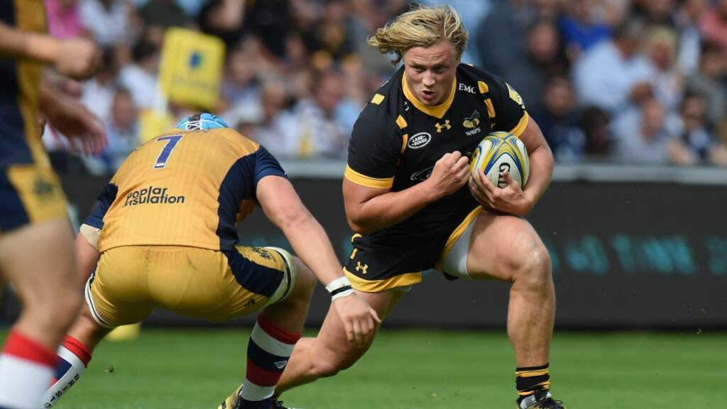 Olly Robinson takes on Wasps' Tommy Taylor