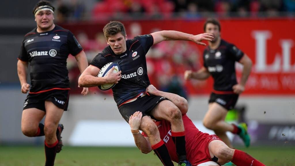 LLANELLI, WALES - JANUARY 15:  Saracens fly half Owen Farrell breaks a tackle on his way to setting up the final Saracens try during the European Rugby Champions Cup match between Scarlets and Sarcens at Parc y Scarlets on January 15, 2017 in Llanelli, United Kingdom.  (Photo by Stu Forster/Getty Images)
