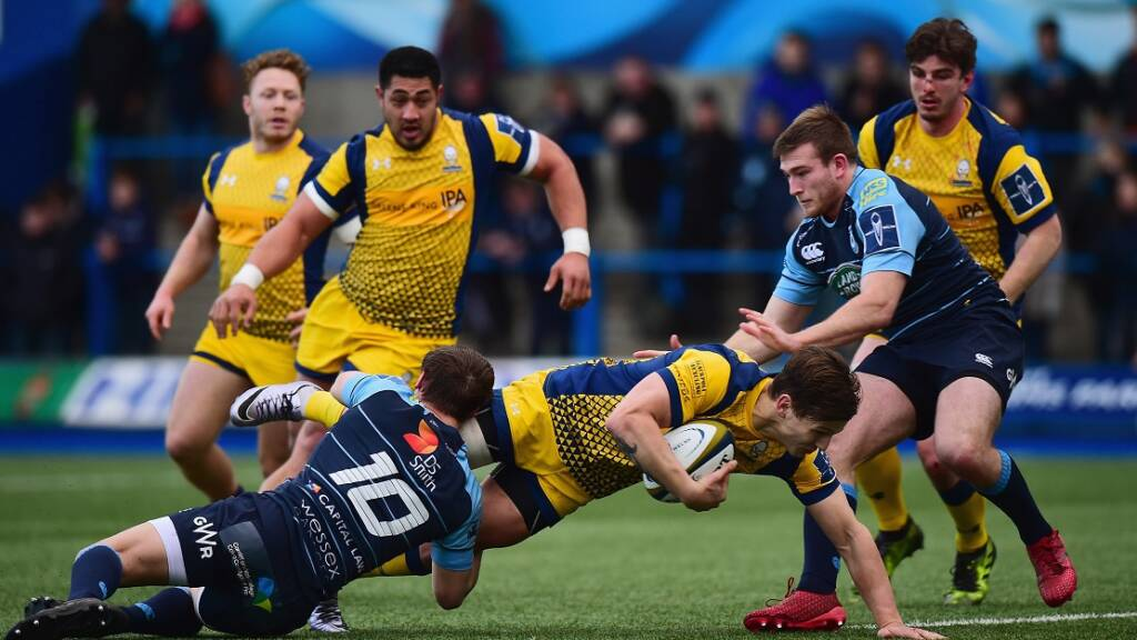 CARDIFF, WALES - FEBRUARY 04: Jarrod Evans of Cardiff Blues tackles Ryan Mills of Worcester Warriors during the Anglo-Welsh Cup match between Cardiff Blues and Worcester Warriors at Cardiff Arms Park on February 4, 2017 in Cardiff, Wales.  (Photo by Tony Marshall/Getty Images)
