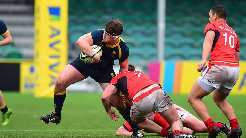 WORCESTER, ENGLAND - FEBRUARY 16:  Tom Furnival of Worcester Warriors U18 is tackled by Sean Reffell of Saracens U18 in the Fifth Place Play Off match between Worcester Warriors U18 and Saracens U18 during the Premiership Rugby Under 18 Academy Finals Day at Sixways Stadium on February 16, 2017 in Worcester, England.  (Photo by Tony Marshall/Getty Images)