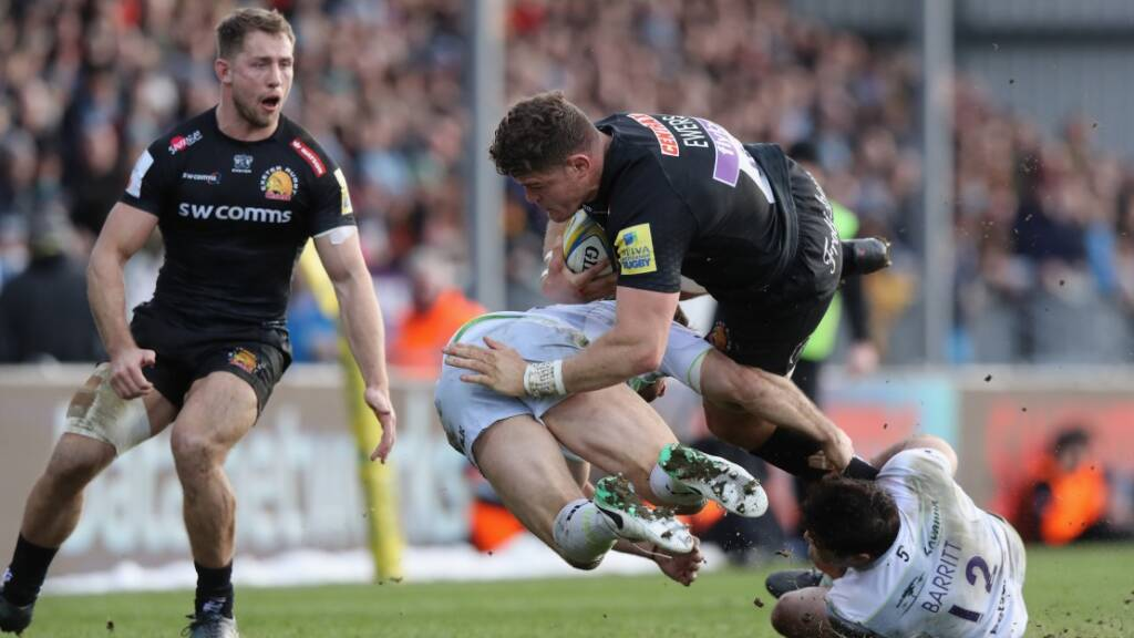 Dave Ewers of Exeter takes on Brad Barritt and Marcelo Bosch (L) during the Aviva Premiership match between Exeter Chiefs and Saracens at Sandy Park