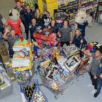 Festive trolley dash sees Sale Sharks stars collect £5,500-worth of gifts for children in Manchester