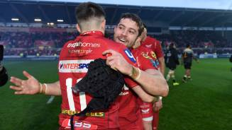 Players and coach celebrate as Scarlets seal European semi-final