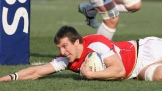 Wales edge frantic encounter
