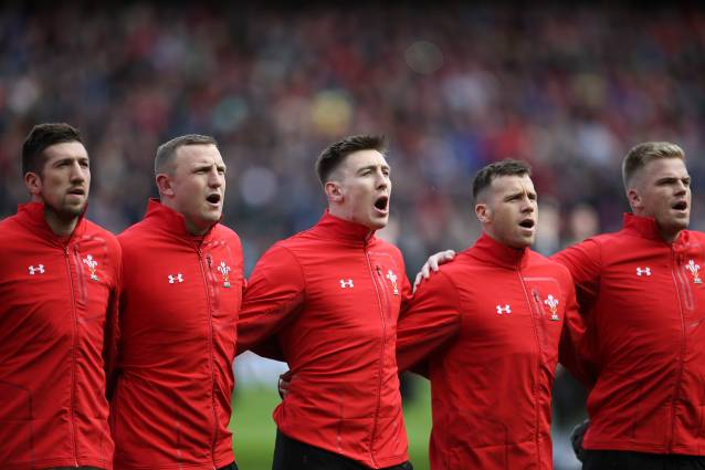 Wales sing the national anthem.
