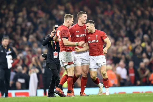 George North celebrates Wales' win against England with Liam Williams and Gareth Davies.