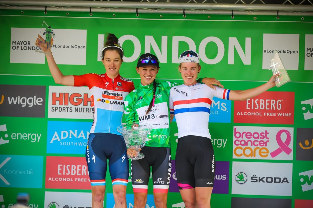 OVO Energy Women's Tour winner Kasia Niewiadoma (centre) flanked by Christine Majerus (left) and Hannah Barnes (right).
