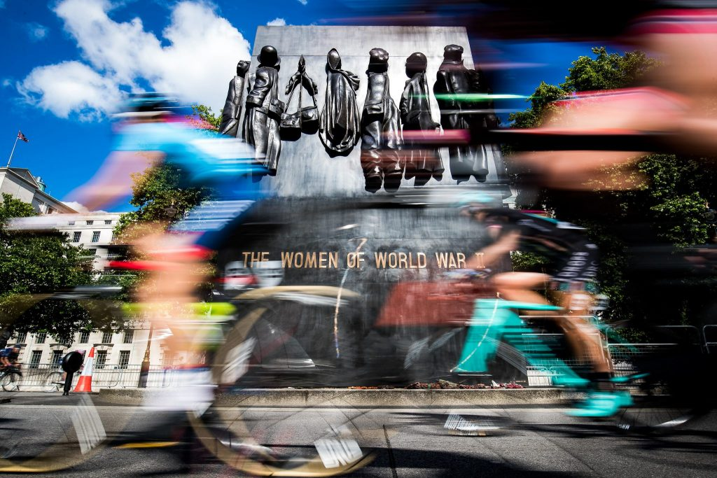 A Picture That Says A Thousand Words - Riders racing past the monument to the Women of World War II, which was raised to commemorate the vital work done by over seven million women during the war.