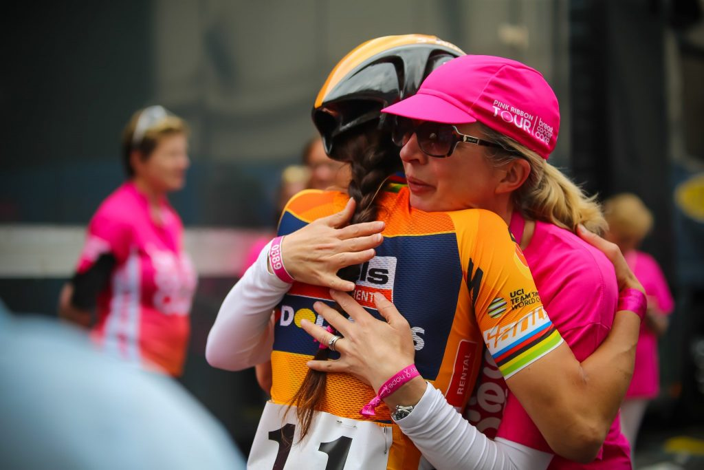 The Hardest Race - Former World Champ Lizzie Deignan meeting her pink ribbon writer behind the podium in London. As part of a partnership with Breast Cancer Care all 102 riders received a motivational message at the start of the race written by someone who had suffered from Breast Cancer.