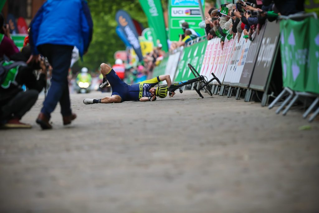 Back To Earth With A Bump - Sarah Roy takes a tumble on the Chesterfield cobbles following her double handed celebration after winning Stage 4.